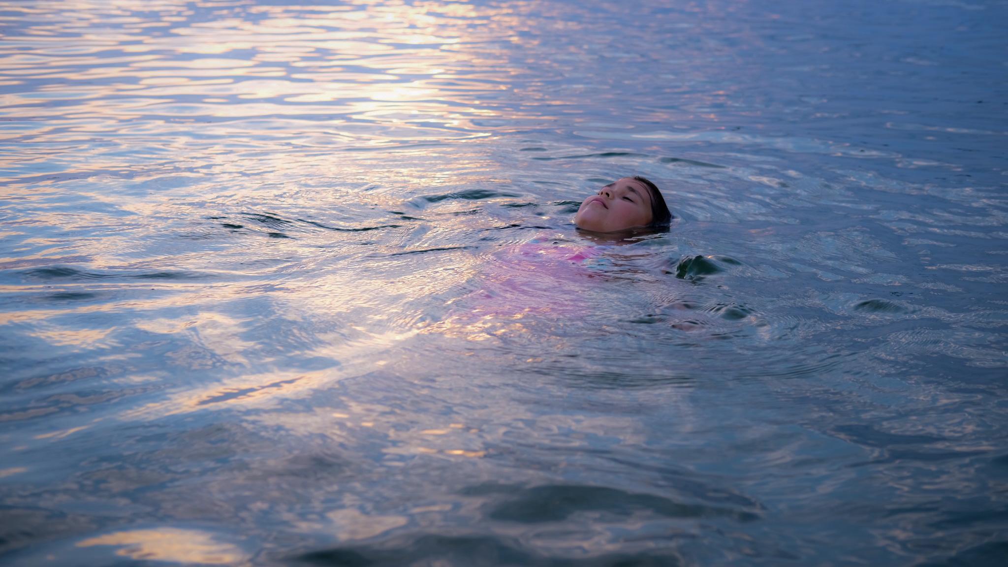 Radha swimming in Trakai Lake
